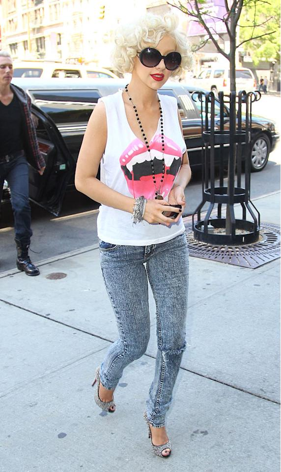 "We love her supersized shades, fabulous fang-adorned tank, and sparkly Christian Louboutin peep-toes, but Christina Aguilera's acid wash jeans are just gross. <a href=""http://www.infdaily.com"" target=""new"">INFDaily.com</a> - May 7, 2010"