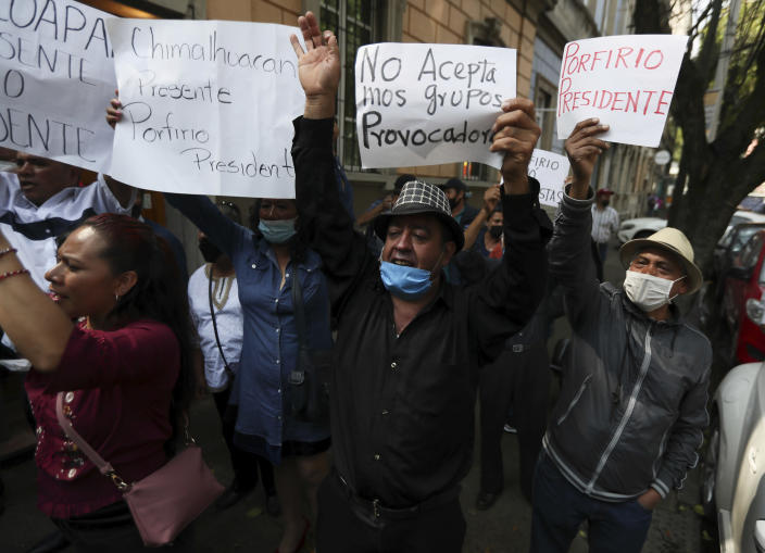 Supporters of Porfirio Munoz Ledo gather outside Morena party headquarters amid elections to select the party's leader in Mexico City, Monday, Oct. 12, 2020. The ruling party is making its third try at electing a party leader. (AP Photo/Fernando Llano)