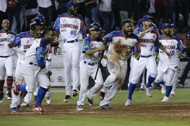 Players of the Dominican Republic's Estrellas Orientales celebrate after defeating Puerto Rico's Cangrejeros de Santurce on thei Caribbean Series baseball tournament match at Rod Carew stadium in Panama City, Thursday, Feb. 7, 2019. (AP Photo/Arnulfo Franco)