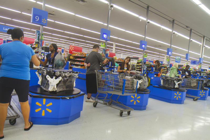 The check out inside Walmart. (Photo by: Jeffrey Greenberg/Universal Images Group via Getty Images)