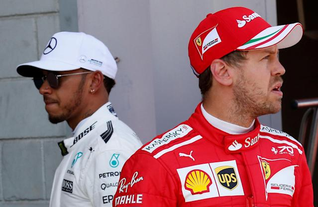 FILE PHOTO: Formula One - F1 - Spanish Grand Prix - Barcelona-Catalunya racetrack, Montmelo Spain - 13/05/17 - Mercedes' Lewis Hamilton and Ferrari's Sebastian Vettel after the qualifying session. REUTERS/Albert Gea/File Photo