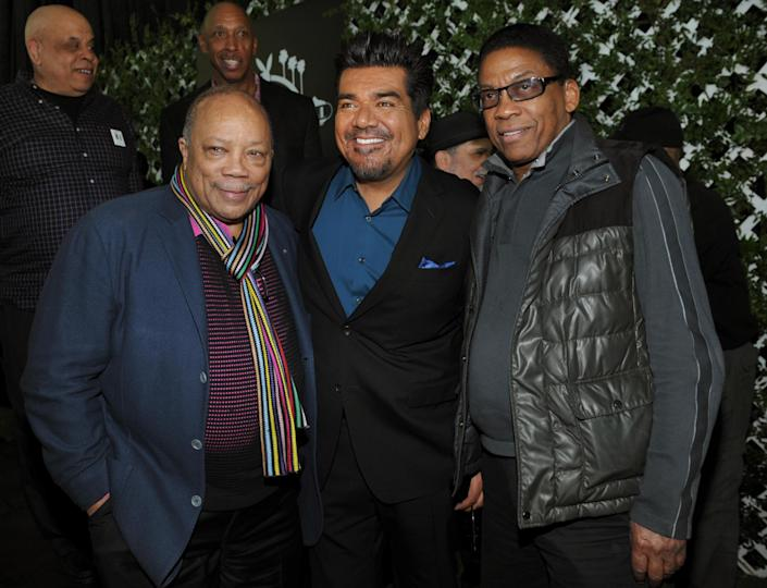 George Lopez, center, master of ceremonies for this year's Playboy Jazz Festival, poses with musicians Quincy Jones, left, and Herbie Hancock following a news conference at the Playboy Mansion on Thursday, Feb. 28, 2013 in Los Angeles. The 35th Anniversary Playboy Jazz Festival will be held at the Hollywood Bowl on June 15 and 16. (Photo by Chris Pizzello/Invision/AP)
