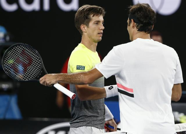 Tennis - Australian Open - Rod Laver Arena, Melbourne, Australia, January 16, 2018. Roger Federer of Switzerland shakes hands with Aljaz Bedene of Slovenia after Federer won their match. REUTERS/Thomas Peter