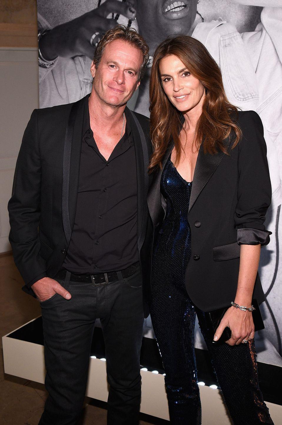 """<p>The supermodel has her agent, Michael Gruber, to thank for connecting her with her husband, Rande Gerber. When Gruber was getting married, he suggested that Crawford and Gerber be each other's dates to his big day. </p><p>""""We decided to meet the night before and get to know each other,"""" <a href=""""http://people.com/archive/cover-story-hello-love-vol-58-no-3/"""" rel=""""nofollow noopener"""" target=""""_blank"""" data-ylk=""""slk:Gerber told People"""" class=""""link rapid-noclick-resp"""">Gerber told <em>People</em></a>. """"I was surprised at how cool and down-to-earth she was.""""</p>"""