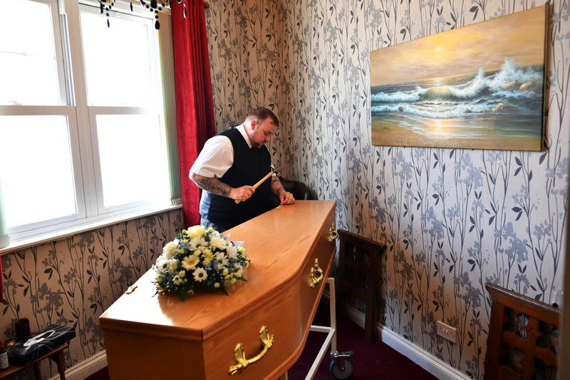 Funeral Director Bobby Palliser prepares a coffin in Sheerness