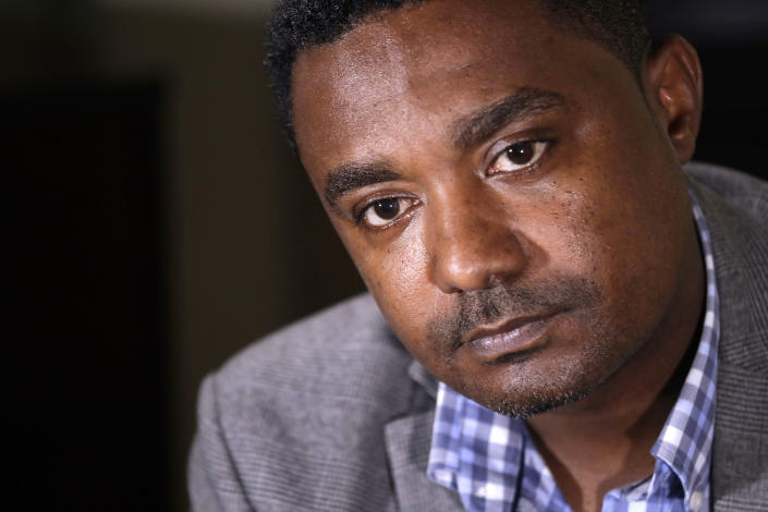 In this photo taken Monday, Sept. 23, 2019, Yonas Yeshanew, who resigned as Ethiopian Airline's chief engineer this summer and is seeking asylum in the U.S., listens to a reporter's question during an interview in Seattle area. Yeshanew says in a whistleblower complaint filed with regulators that the carrier went into the maintenance records on a Boeing 737 Max jet a day after it crashed this year, a breach he contends was part of a pattern of corruption that included fabricating documents, signing off on shoddy repairs and even beating those who got out of line. (AP Photo/Elaine Thompson)