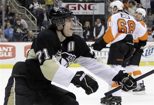 Pittsburgh Penguins' Evgeni Malkin (71) celebrates his 50th goal of the season, in the second period of an NHL hockey game against the Philadelphia Flyers in Pittsburgh Saturday, April 7, 2012. (AP Photo/Gene J. Puskar)
