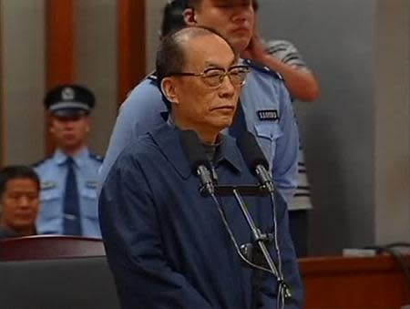 File still image taken from video of China's former railways minister, Liu, attending a trial for charges of corruption and abuse of power at a courthouse in Beijing