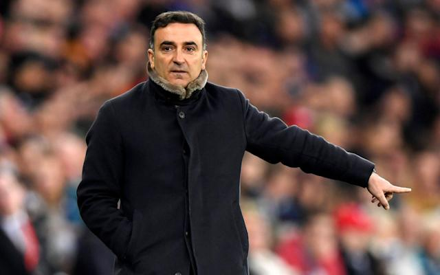 """If the decline in the standard of Carlos Carvalhal's analogies are anything to go by then Swansea truly are back on the slide at exactly the wrong time in the relegation fight. The maverick Portuguese who arrived at the Liberty at the end of last year delivering delicious bon mots involving sardines, lobsters, Ferraris and crematoriums was at the training ground on Thursday resorting to the """"glass half-full"""" adage. However, perhaps the unoriginality did not matter as this was definitely a cliché he wanted to get off his chest. Carvalhal has heard all the renewed negativity concerning his team's plight as they sit one point out of the bottom three with three games to go, and knows there are whispers about his ability to finish off the saviour act. Under his management, Sheffield Wednesday fell despairingly short of the play-offs in the previous two seasons and the theory goes that this eccentric character tightens up at the business end. If that is a cruel assessment of the 52-year-old – and it surely is when one considers the competitiveness of the Championship – then perhaps it is nothing to the criticisms of the six-game winless streak that has pulled the Swans back into the dogfight. A trip to Bournemouth awaits on Saturday, followed by home games against the two clubs directly below them in Southampton and Stoke respectively. Yet while the bum may squeak, Carvalhal is adamant the conviction should not waver and demands any doubters remember the position they were in when he took over on Dec 28 following Paul Clement's sacking. Premier League and Football League relegation, promotion and play-offs """"We were five points adrift at the bottom and in last place,"""" Carvalhal said. """"We were dead – nobody believed. So when you get to this moment where we are not in the relegation zone and with it in our hands, it is fantastic, not negative. """"We play three games, two at home against teams near us in the table and, when we arrived, 100 per cent of people said this was impos"""