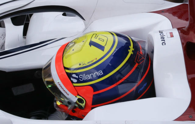 Sauber driver Charles Leclerc of Monaco wears a special helmet as tribute to Jules Bianchi during the second free practice at the Monaco racetrack, in Monaco, Thursday, May 24, 2018. The Formula one race will be held on Sunday. (AP Photo/Luca Bruno)