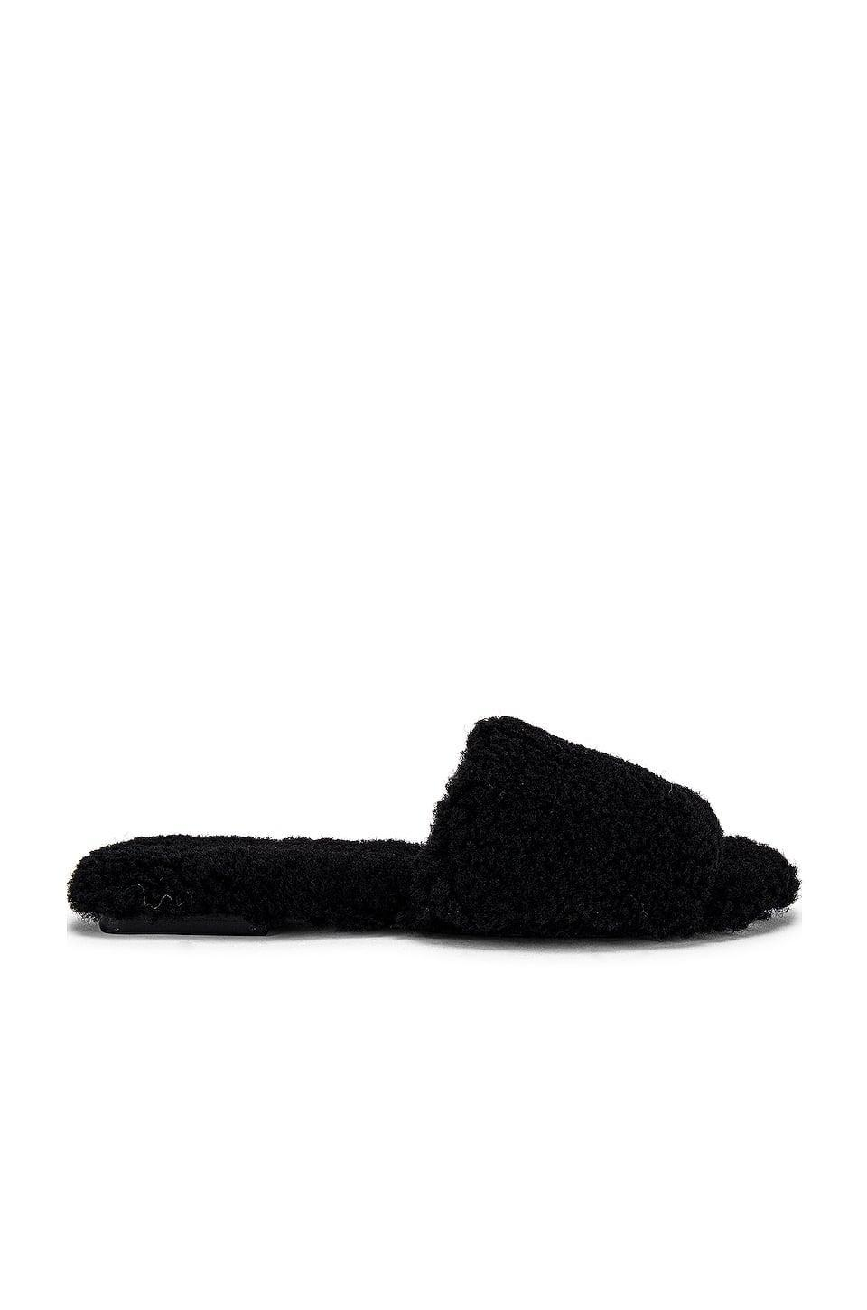 <p>Get cozy in these cute <span>Raye Shearling Sandals</span> ($148).</p>