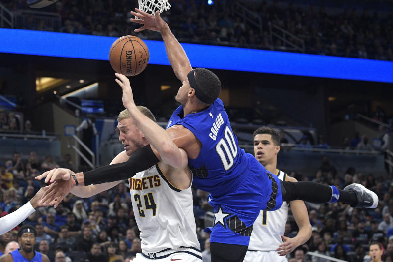 Murray, Jokic lead Nuggets past Magic, 91-87