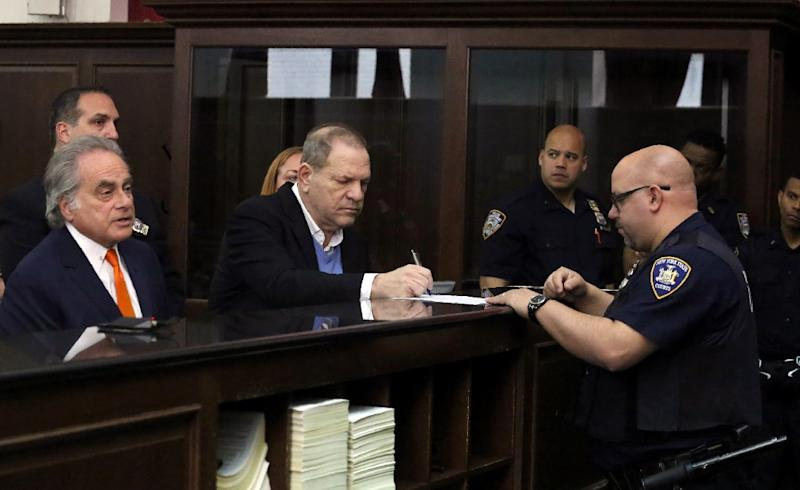 Disgraced Hollywood mogul Harvey Weinstein (C), at his arraignment in New York May 25, 2018 on rape and sex crimes charges (AFP Photo/Steven Hirsch)
