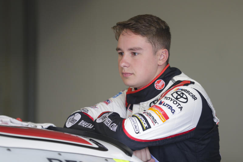NASCAR Xfinity Series driver Christopher Bell waits in the garage area before the start of NASCAR Xfinity auto racing practice at Indianapolis Motor Speedway, Friday, Sept. 6, 2019 in Indianapolis. (AP Photo/Michael Conroy)