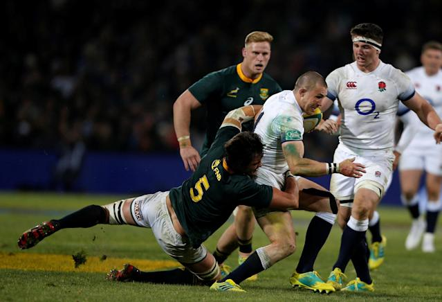 Rugby Union - Second Test International - South Africa v England - Free State Stadium, Bloemfontein, South Africa - June 16, 2018. South Africa's Franco Mostert tackles England's Mike Brown. REUTERS/Siphiwe Sibeko