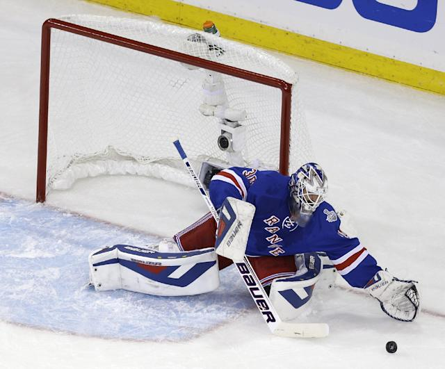 New York Rangers goalie Henrik Lundqvist (30) makes a save in the first period during Game 4 of the NHL hockey Stanley Cup Final against the Los Angeles Kings, Wednesday, June 11, 2014, in New York. (AP Photo/Seth Wenig)