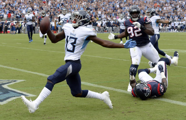 <p>Tennessee Titans wide receiver Taywan Taylor (13) scores a touchdown ahead of Houston Texans defensive tackle Brandon Dunn (92) in the first half of an NFL football game Sunday, Sept. 16, 2018, in Nashville, Tenn.(AP Photo/Mark Zaleski) </p>