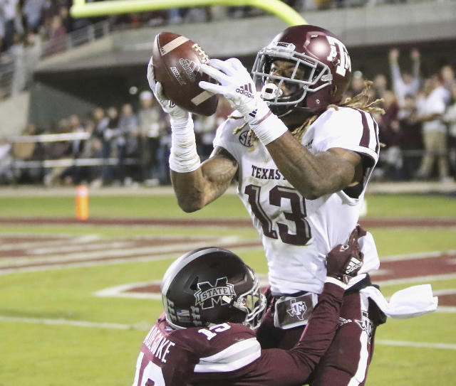 Texas A&M wide receiver Kendrick Rogers (13) attempts to catch a pass as Mississippi State safety Stephen Adegoke (19) defends during the first half of their NCAA college football game on Saturday, Oct. 27, 2018, in Starkville, Miss. The pass to Rogers was ruled incomplete.(AP Photo/Jim Lytle)