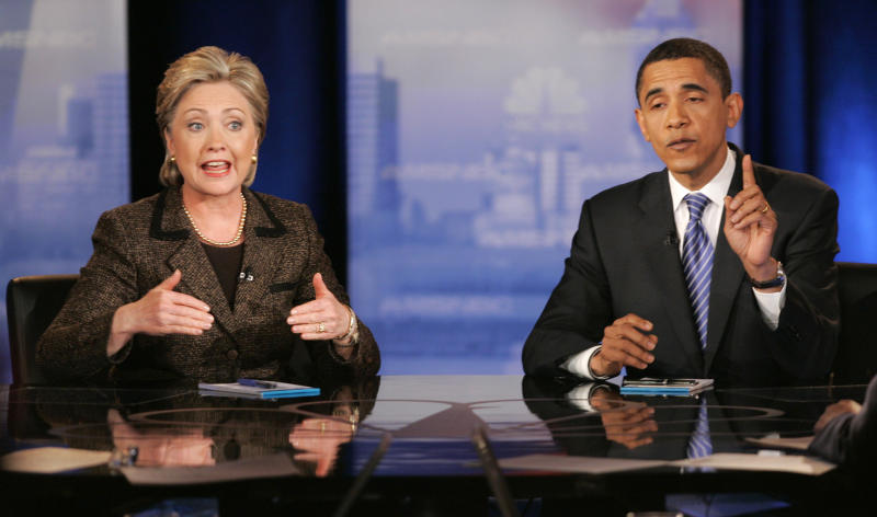 """FILE - In this Feb. 26, 2008, file photo, then Democratic presidential hopefuls Sen. Hillary Rodham Clinton, D-N.Y., left, and Sen. Barack Obama, D-Ill., respond to a question during a Democratic presidential debate in Cleveland. Mitt Romney pulled the plug on his first presidential run on Feb. 7, 2008, and immediately served notice that he wasn't about to fade away. """"I hate to lose,"""" he told conservatives that day. Obama wasn't paying too much attention to Romney just then. The first-term Illinois senator was in a bare-knuckled brawl with Clinton for the Democratic presidential nomination and, if he got past the New York senator and former first lady, was calculating his odds of defeating Republican Sen. John McCain.(AP Photo/Mark Duncan, File)"""