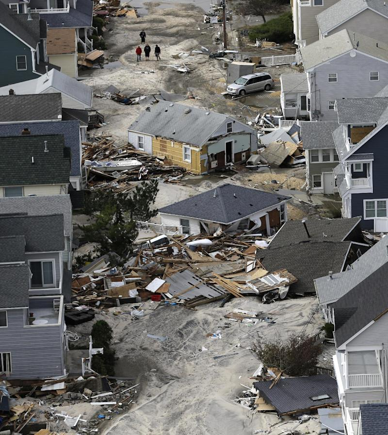 FILE - This Wednesday, Oct. 31, 2012 file aerial photo shows the destroyed homes  left in the wake of Superstorm Sandy, in Seaside Heights, N.J. Thousands of New Jersey residents displaced by Sandy are frantically calling real estate offices, looking to rent a home or apartment while they figure out what to do about their storm-ravaged homes. Others are joining waiting lists at hotels filled with evacuees and out-of-state utility workers. (AP Photo/Mike Groll, File)