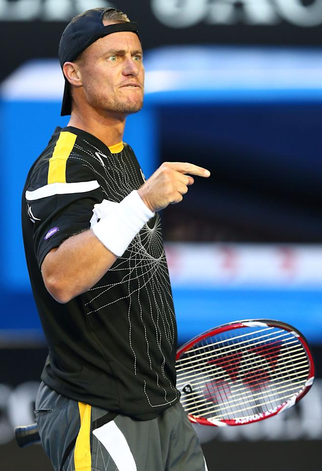 MELBOURNE, AUSTRALIA - JANUARY 14:  Lleyton Hewitt of Australia reacts in his first round match against Janko Tipsarevic of Serbia during day one of the 2013 Australian Open at Melbourne Park on January 14, 2013 in Melbourne, Australia.  (Photo by Ryan Pierse/Getty Images)
