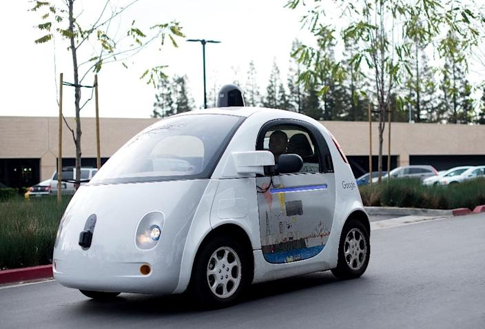 A self-driving car traverses a parking lot at Google's headquarters in Mountain View, California (AFP Photo/Noah Berger)