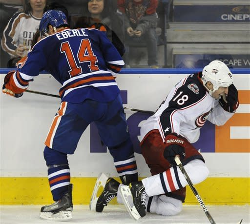 Columbus Blue Jackets R.J. Umberger, right, takes a stick to the face from Edmonton Oilers' Jordan Eberle during third period NHL action in Edmonton, Alberta, on Wednesday, March 14, 2012. (AP Photo/THE CANADIAN PRESS/John Ulan)