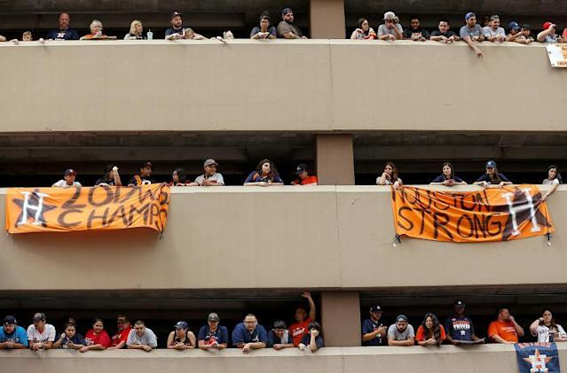 Houston Astros fans wait for the start of the World Series Championship parade from a parking structure along Smith Street in Houston. (AP/Houston Chronicle )