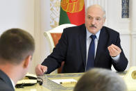 Belarusian President Alexander Lukashenko speaks at a meeting on issues of functioning and increasing the efficiency of the construction industry in Minsk, Belarus, Friday, Aug. 14, 2020. In five days of massive protests, crowds of demonstrators swarmed the streets to contest the vote results and demand an end to the 26-year rule of authoritarian President Alexander Lukashenko. Nearly 7,000 people have been detained and hundreds injured. (Andrei Stasevich/BelTA, Pool Photo via AP)