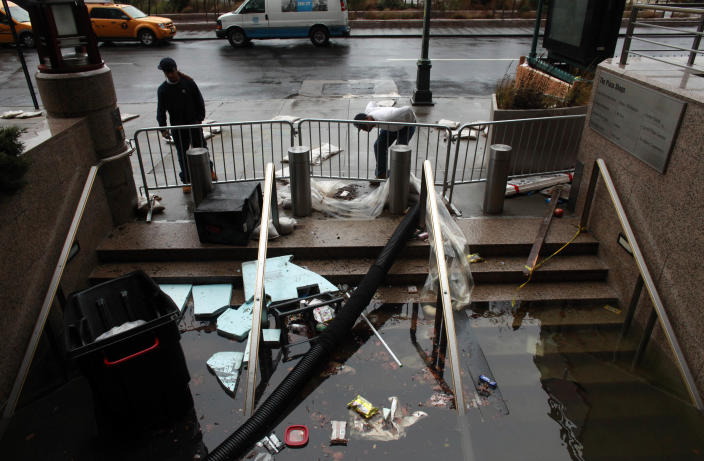 Water floods the Plaza Shops in Manhattan, New York. (Getty Images/Allison Joyce)