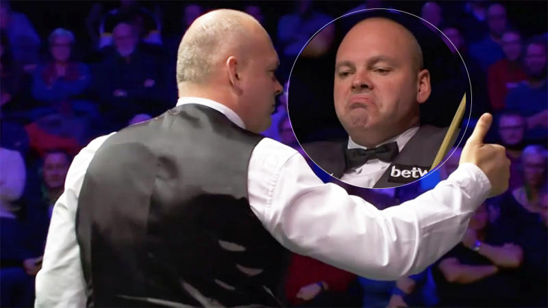 Snooker champion Stuart Bingham is pictured gesturing to a person in the audience after he was distracted by their mobile phone ringing.