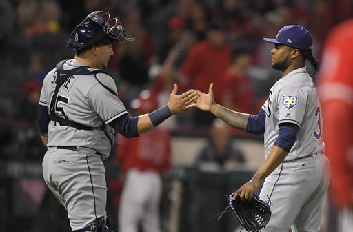 Tampa Bay Rays catcher Jesus Sucre and relief pitcher Alex Colome congratulate each other after the Rays defeated the Los Angeles Angels 5-3 on Saturday. (AP Photo/Mark J. Terrill)