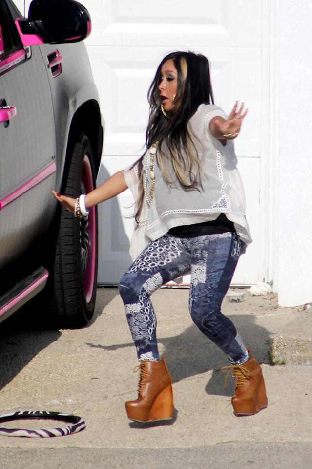 "But don't expect to see Nicole ""Snooki"" Polizzi, who almost took a tumble in her sky-high platform booties, crashing at the party pad. The pregnant reality star will be staying nearby with her fiance Jionni LaValle. ""I don't want to be one of those moms who's pregnant in a club,"" she told <a target=""_blank"" href=""http://www.usmagazine.com/celebrity-news/news/pregnant-snooki-not-living-in-jersey-shore-house-2012235"">Us Weekly</a> in March. ""It's disgusting!""<br>(5/31/2012)<b><br></b><div style=""color:#000000;background-color:#ffffff;text-align:left;text-decoration:none;""><br><br></div>"