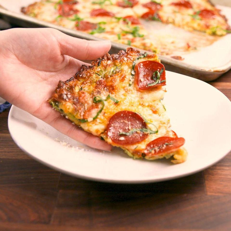 """<p>Have your <a href=""""https://www.delish.com/uk/cooking/recipes/a30686833/homemade-pizza-recipe/"""" rel=""""nofollow noopener"""" target=""""_blank"""" data-ylk=""""slk:pizza"""" class=""""link rapid-noclick-resp"""">pizza</a> and your diet too. </p><p>Get the <a href=""""https://www.delish.com/uk/cooking/recipes/a33453360/zucchini-pizza-crust-recipe/"""" rel=""""nofollow noopener"""" target=""""_blank"""" data-ylk=""""slk:Courgette Pizza Crust"""" class=""""link rapid-noclick-resp"""">Courgette Pizza Crust</a> recipe.</p>"""