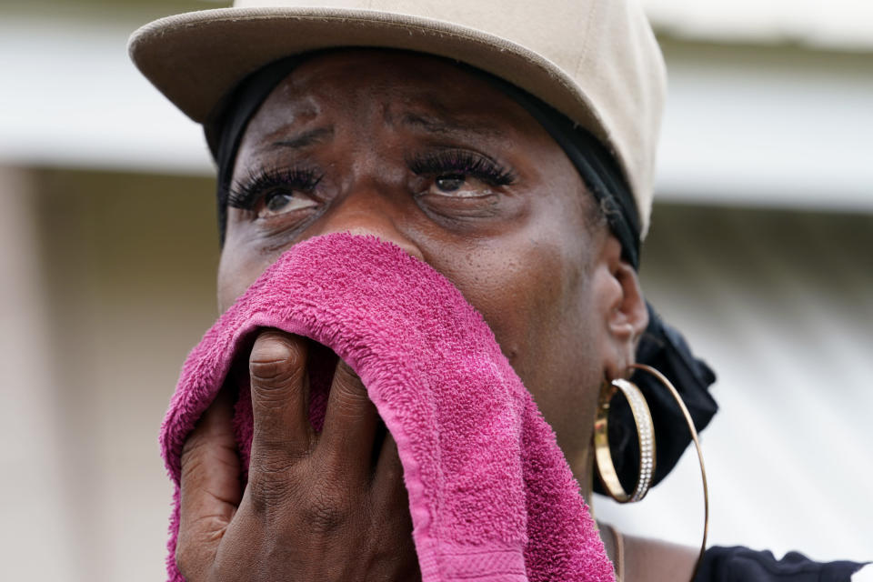 Rakisha Murray cries in relief as she arrives to see her mother's home undamaged, after she returned from evacuation with her mother and other family in Lake Charles, La., in the aftermath of Hurricane Laura, Sunday, Aug. 30, 2020. (AP Photo/Gerald Herbert)