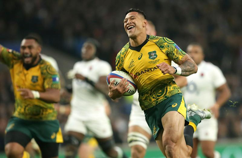 Australia's Israel Folau smiles as he crosses for a try during the rugby union international between England and Australia at Twickenham in London, Saturday, Nov. 24, 2018. (AP Photo/Tim Ireland)