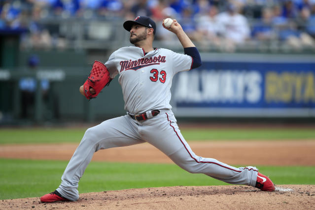 Minnesota Twins starting pitcher Martin Perez delivers to a Kansas City Royals batter during the first inning of a baseball game at Kauffman Stadium in Kansas City, Mo., Sunday, Sept. 29, 2019. (AP Photo/Orlin Wagner)