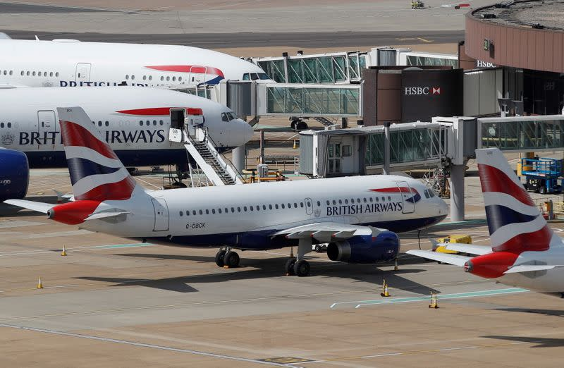 FILE PHOTO: British Airways aircraft are parked at the South Terminal at Gatwick Airport, in Crawley