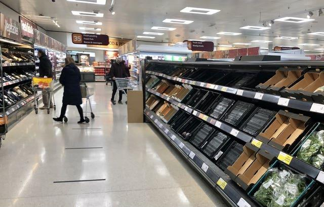 Depleted shelves in Sainsbury's at the Forestside shopping centre in Belfast