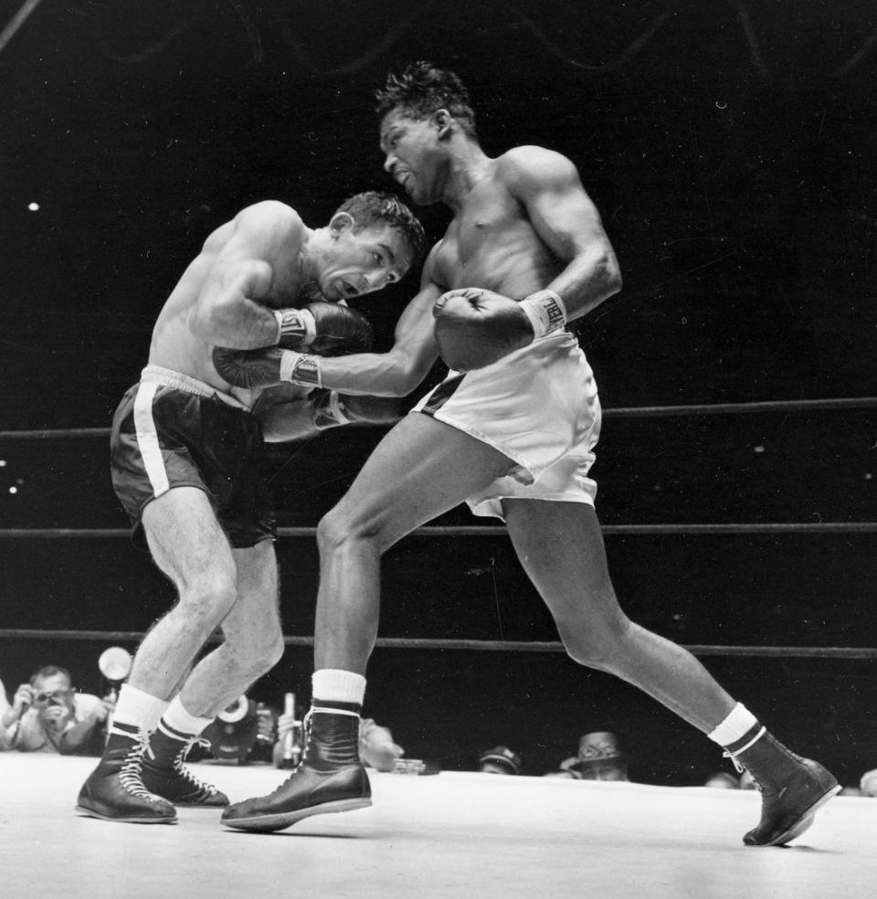 13. Sugar Ray Robinson KO5 Gene Fullmer, May 1, 1957 – Four months earlier, Robinson lost the middleweight title to Fuller in New York. They rematched in Chicago and Fullmer was again doing well when Robinson hit him with a left hook to the jaw that put Fullmer out cold. (Photo credit: AP file) Note: Photo shows Robinson fighting Carmen Basilio.