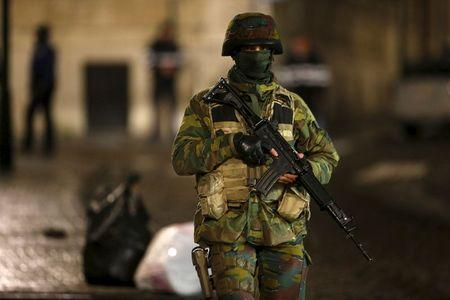 A Belgian soldier patrols along a street during a continued high level of security following the recent deadly Paris attacks, in Brussels, Belgium, November 22, 2015. REUTERS/Youssef Boudlal