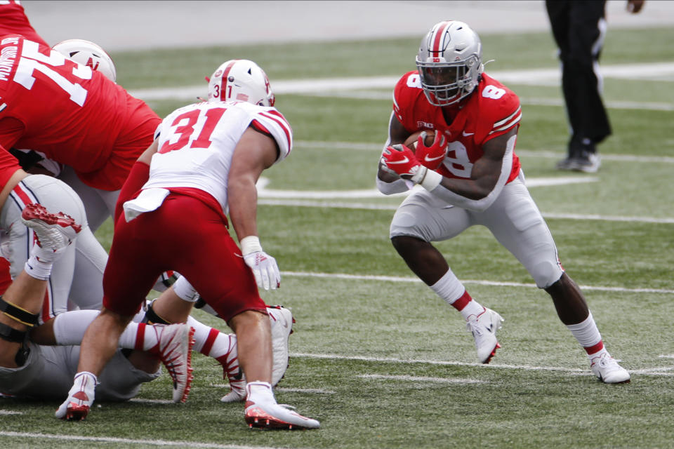 Ohio State running back Trey Sermon, right, cuts up field against Nebraska linebacker Collin Miller during the first half of an NCAA college football game Saturday, Oct. 24, 2020, in Columbus, Ohio. (AP Photo/Jay LaPrete)