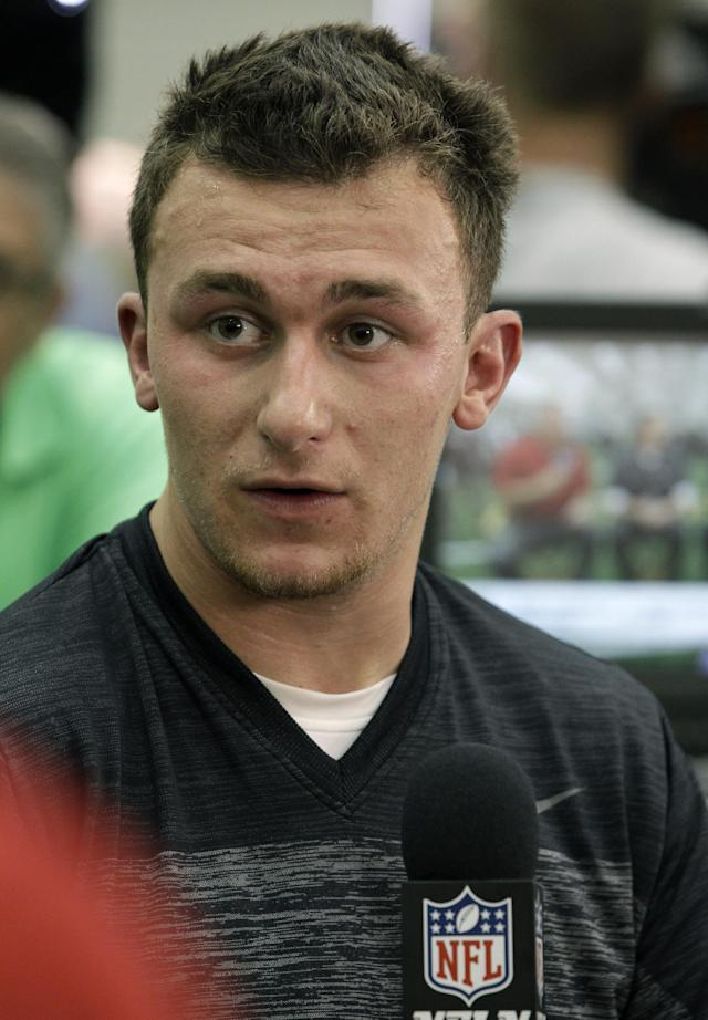 Texas A&M quarterback Johnny Manziel talks to members of the media during pro day for NFL football representatives in College Station, Texas, Thursday, March 27, 2014. (AP Photo/Patric Schneider)