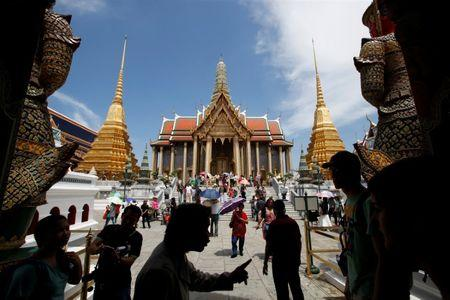 FILE PHOTO - Tourists visit the Grand Palace in Bangkok