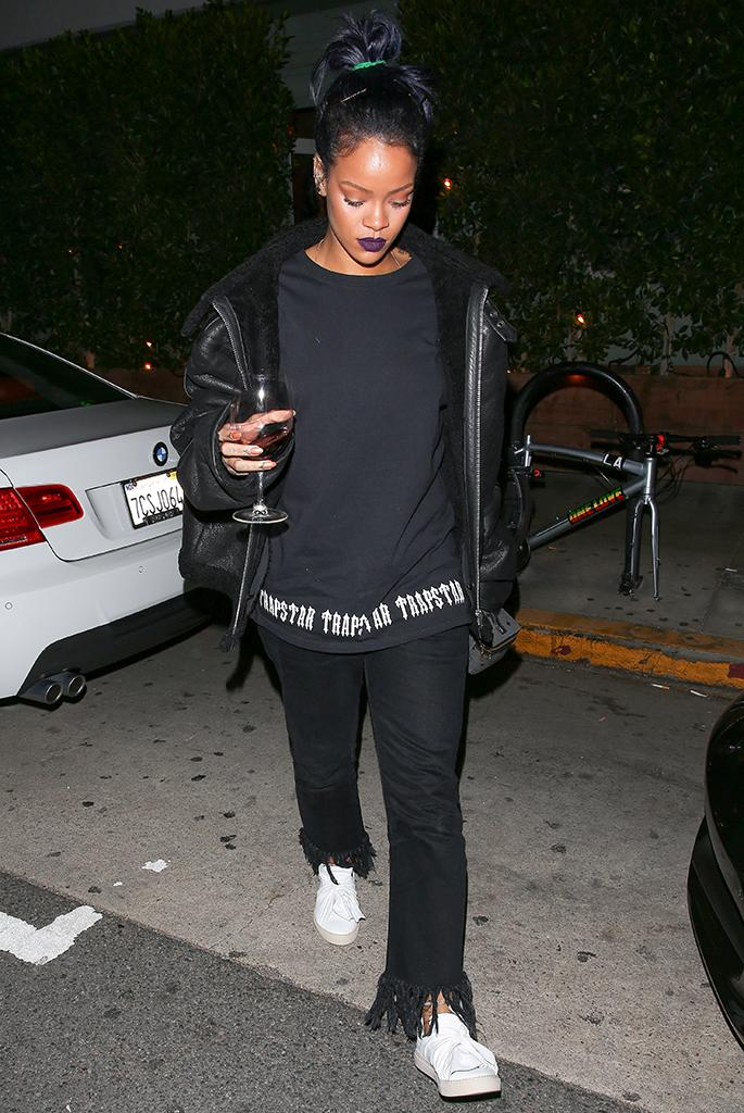 Rihanna takes the party to go, exiting an L.A. restaurant with her drink. (Photo: AKM-GSI)