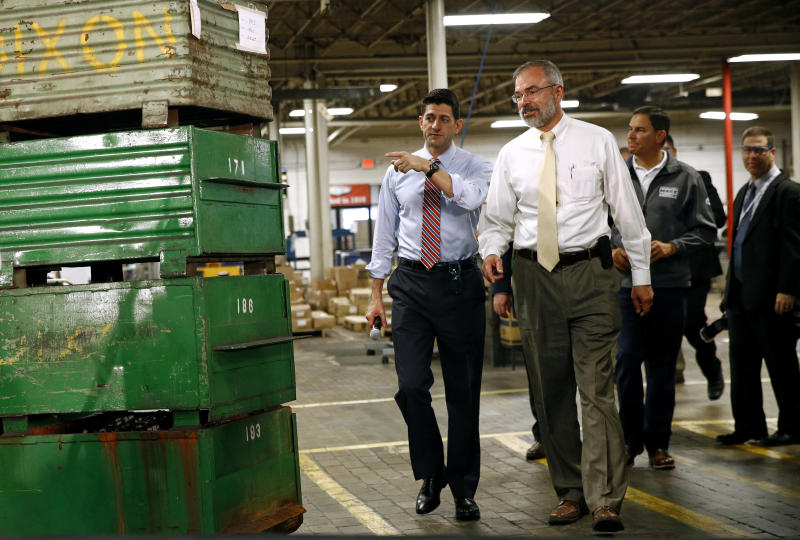 Speaker of the House Paul Ryan, R-Wis., left, and Rep. Andy Harris, R-Md., right, approach a stage before holding a tax reform town hall with employees at the Dixon Valve & Coupling Company factory in Chestertown, Md., Thursday, Oct. 5, 2017. (AP Photo/Patrick Semansky)