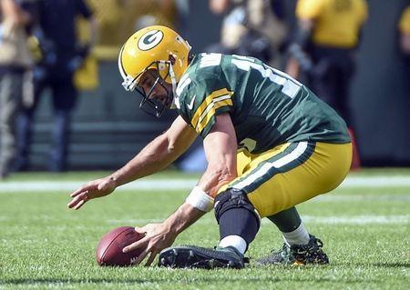Sep 16, 2018; Green Bay, WI, USA; Green Bay Packers quarterback Aaron Rodgers (12) recovers his own fumble in the fourth quarter during the game against the Minnesota Vikings at Lambeau Field. Mandatory Credit: Benny Sieu-USA TODAY Sports