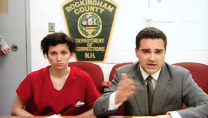 In this photo taken from a television monitor in district court in Derry, N.H.. Kathryn McDonough, left, appears during her video arraignment with lawyer Ryan Russman from the Rockingham County jail in Brentwood, N.H.  Bail was set at $35,000 for McDonough, who is charged with lying to investigators about her whereabouts and involvement in the disappearance and death of a college student her boyfriend is accused of killing. (AP Photo)