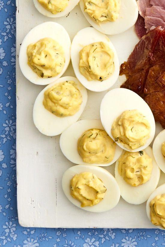 """<p>These aren't your ordinary deviled eggs! They're packed with flavor, made with fresh chives, dill, chopped pickles, and a few dashes of hot sauce.</p><p><strong><a href=""""https://www.thepioneerwoman.com/food-cooking/recipes/a35566272/herbed-deviled-eggs-recipe/"""" rel=""""nofollow noopener"""" target=""""_blank"""" data-ylk=""""slk:Get the recipe."""" class=""""link rapid-noclick-resp"""">Get the recipe.</a></strong></p><p><a class=""""link rapid-noclick-resp"""" href=""""https://go.redirectingat.com?id=74968X1596630&url=https%3A%2F%2Fwww.walmart.com%2Fsearch%2F%3Fquery%3Dpioneer%2Bwoman%2Bcutting%2Bboard&sref=https%3A%2F%2Fwww.thepioneerwoman.com%2Ffood-cooking%2Fmeals-menus%2Fg35585877%2Feaster-recipes%2F"""" rel=""""nofollow noopener"""" target=""""_blank"""" data-ylk=""""slk:SHOP CUTTING BOARDS"""">SHOP CUTTING BOARDS</a></p>"""