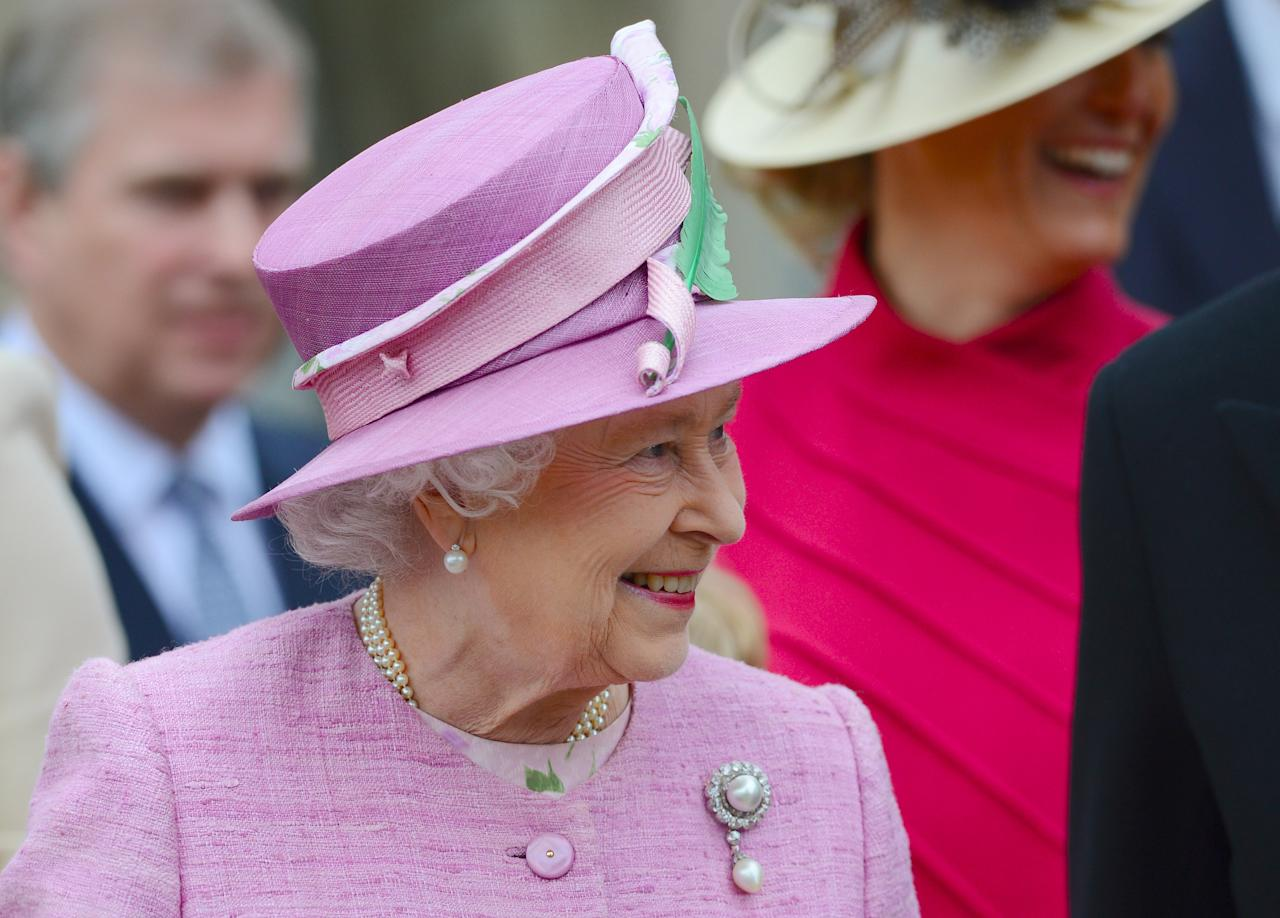 WINDSOR, ENGLAND - APRIL 08: Queen Elizabeth II smiles as she leaves Saint George's Chapel in Windsor Castle after attending the Easter Mattins Service on April 8, 2012 in Windsor, United Kingdom.  (Photo by Leon Neal - WPA Pool/Getty Images)